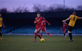 10-men Reds see off Rocks to Remain top